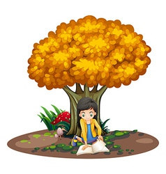 A girl reading under the tree vector