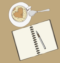Notebook and a cup of coffee vector