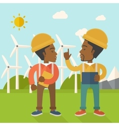 Two black workers talking infront of windmills vector
