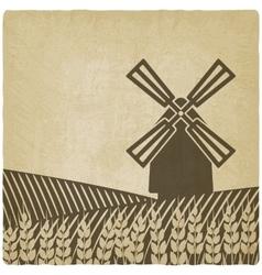 Windmill in wheat field vector