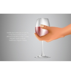 Glass of red wine in hand vector