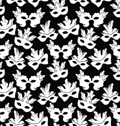 Seamless pattern with carnival mask vector