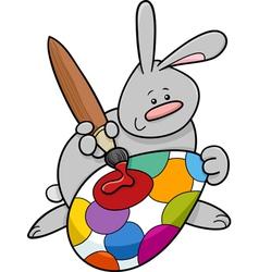 Easter bunny painting egg cartoon vector