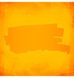 Orange brush spot on grunge background vector