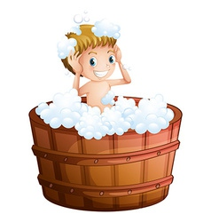 A young boy taking a bath at the big bathtub vector