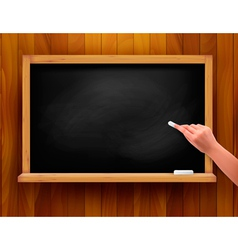 Blackboard with hand on wooden background vector