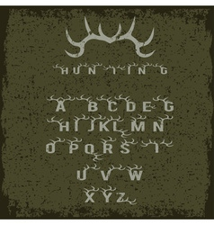 Grunge hunting alphabet with horns vector