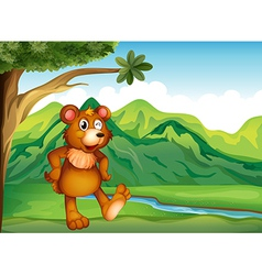 An animal playing near the mountain vector