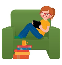 Girl sitting in a chair with the tablet vector
