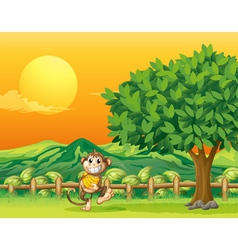 A monkey carrying his food at the bridge vector