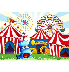 A blue monster near the circus tents vector