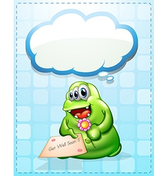 A cheerful green monster holding a card and a vector