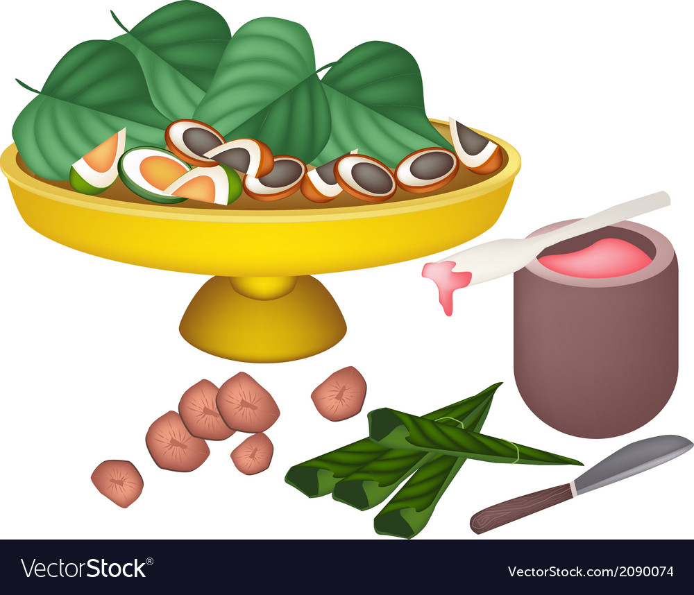 Ripe areca nuts and betel leaves on a tray vector | Price: 1 Credit (USD $1)