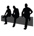 Three men sit on the fence vector