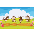 Monkeys playing in the garden vector