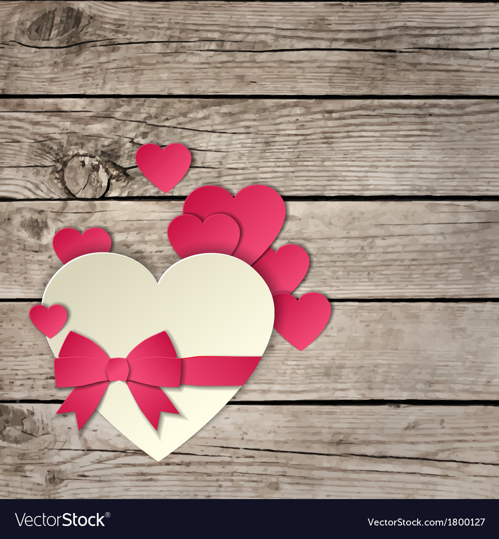 Heart with a bow on a wooden background vector | Price: 1 Credit (USD $1)
