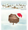 Winter holiday christmas background with a village vector