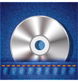 Cd on a blue jeans background vector