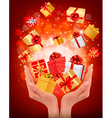 Holiday background with hands holding gift boxes vector