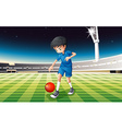 A boy playing soccer at the field vector