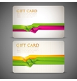 Gift cards with multicolored ribbons vector