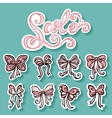 Set of stickers with ornamental holiday bows vector