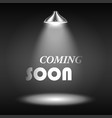 Coming soon text illuminated by spotlight vector