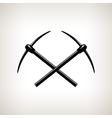 Silhouettes of two crossed pickaxes vector