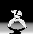 The the man is engaged in karate on a black white vector