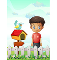 A boy near the pethouse with a bird and a wooden vector