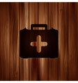 First aid kit icon wooden background vector