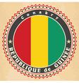Vintage label cards of guinea flag vector