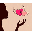 Beautiful girl silhouette with hearts vector