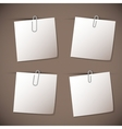 Note papers with paperclip on brown background vector