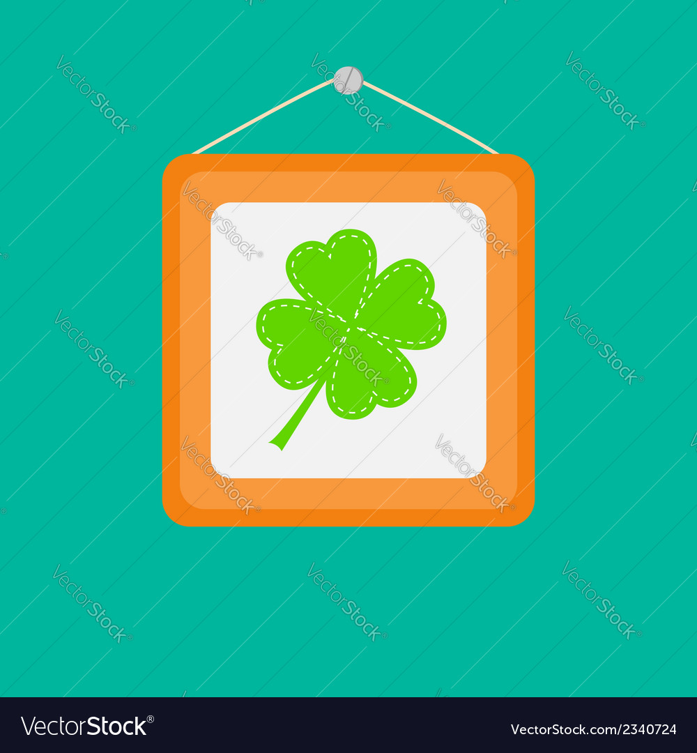 Four leaf clover in a picture frame on the wall vector | Price: 1 Credit (USD $1)
