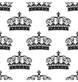 Seamless background pattern of a royal crowns vector