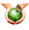 Green world with leaf and butterfly in woman hands vector