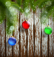 Christmas tree with decoration on a wooden surface vector