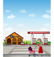A mother walking along a garage and gasoline vector