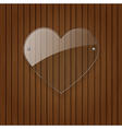 Glass heart over wooden background vector