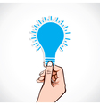 Blue bulb sticker in hand vector