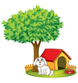 A white puppy beside a doghouse under a big tree vector