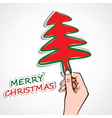 Christmas tree in hand vector