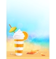 Glass of exotic orange cocktail on beach vector