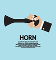 Vintage horn with hand vector