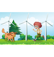 A boy playing with his dog near the windmill vector