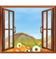 A window with a view of the blooming flowers vector