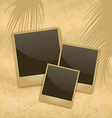 Old style empty photo cards lying on a sea sand vector