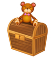 A bear at the top of a treasure chest vector
