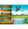 Birds near a blank wooden signage vector
